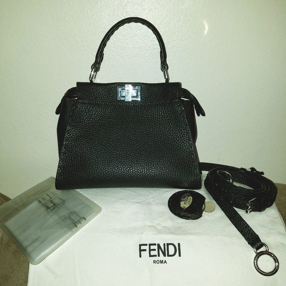 082f71ac4912 Fendi Handbags - Fendi Mini Peekaboo Selleria Leather